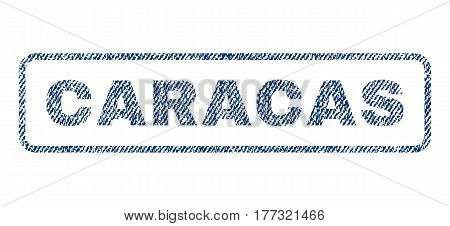 Caracas text textile seal stamp watermark. Blue jeans fabric vectorized texture. Vector tag inside rounded rectangular shape. Rubber emblem with fiber textile structure.