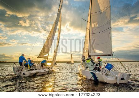 Konakovo April 19 : Public open.  Team athletes participating in the sailing competition - match race held in Konakovo on river Volga April 19 2016