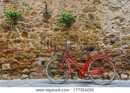 Red Bicycle contrasting with liht wall texture