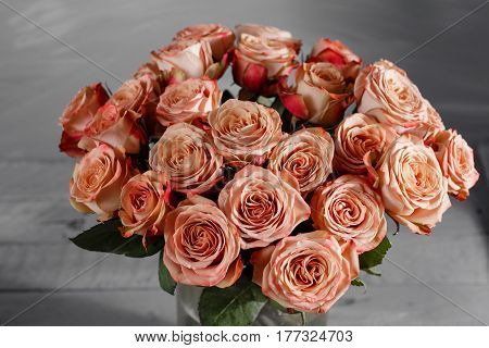 Flowers. Bouquet of capuchino roses on wooden table. Vintage Valentine Floral background