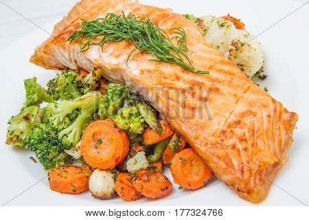 Salmon Fillet On A Bed Of Broccoli, Cauliflower And Carrots