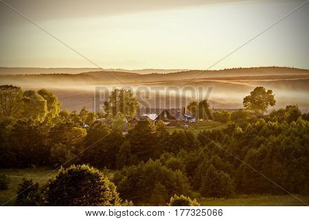 Morning with fog at cottage in village at dawn for print. Residence for family and happiness