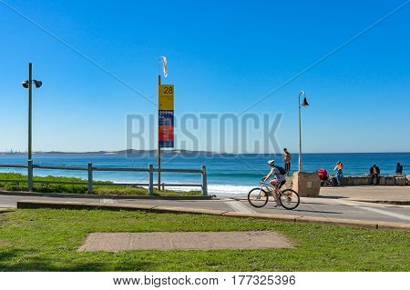 Cronulla, Australia - July 29, 2013: Cronulla suburb on sunny day with people busy with everyday activities
