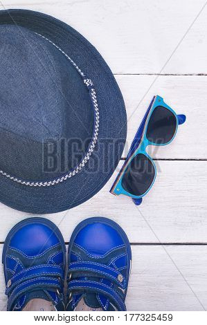 Children's accessories for travel at summer. vertical photo