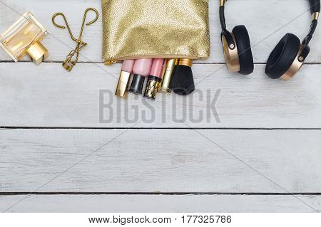 Cosmetic lip gloss in cosmothic golden color. flat lay