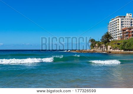 Cronulla coastline view with waterfront properties on sunny day