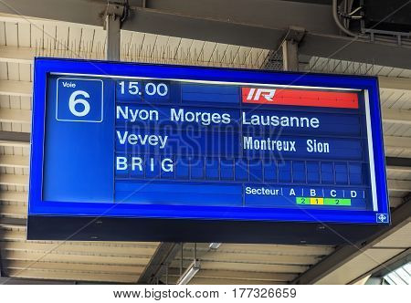 Geneva, Switzerland - 24 September, 2016: informational display over a platform of the Geneva railway station indicating the departure time for a passenger train to the city of Brig. The Geneva railway station has over 230 train arrivals daily.