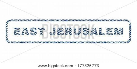 East Jerusalem text textile seal stamp watermark. Blue jeans fabric vectorized texture. Vector caption inside rounded rectangular shape. Rubber emblem with fiber textile structure.