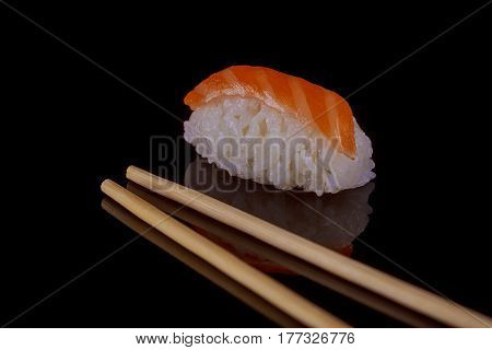 Classic Sushi With Salmon Over Black Background
