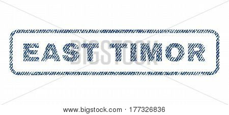 East Timor text textile seal stamp watermark. Blue jeans fabric vectorized texture. Vector tag inside rounded rectangular shape. Rubber sticker with fiber textile structure.