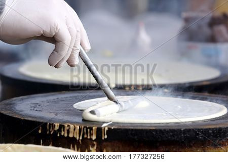 the a making pancakes on the stove