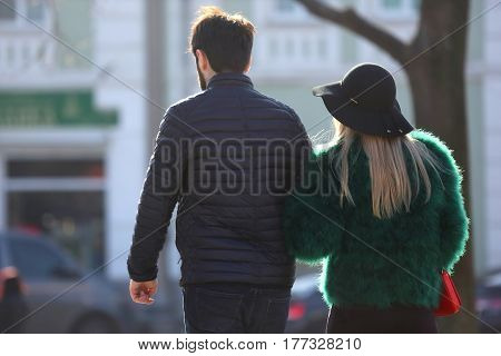 man and woman walking together on the street