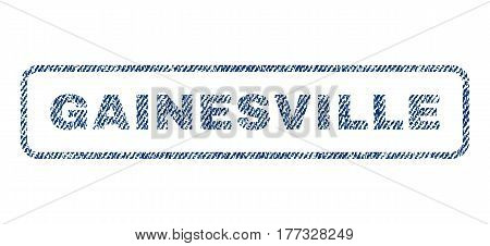 Gainesville text textile seal stamp watermark. Blue jeans fabric vectorized texture. Vector tag inside rounded rectangular shape. Rubber sign with fiber textile structure.