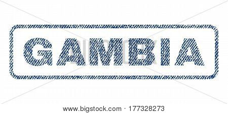 Gambia text textile seal stamp watermark. Blue jeans fabric vectorized texture. Vector tag inside rounded rectangular banner. Rubber sign with fiber textile structure.