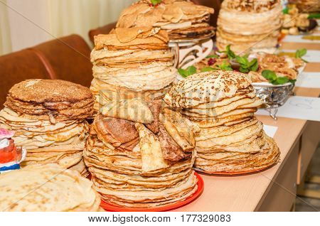 A lot of different pancakes while celebrating  Russian Shrovetide (pancake week) in school