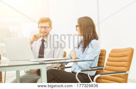 experienced staff of the company discuss the current problems at the Desk in the conference room.the photo has a empty space for your text