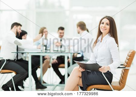 leading lawyer of the company on background, business meeting business partners. the photo has a empty space for your text. leading lawyer of the company on background, business meeting business partners. the photo has a empty space for your text.