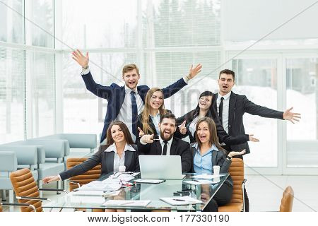 professional business team is delighted with the achievements of the joint work.the photo has a empty space for your text