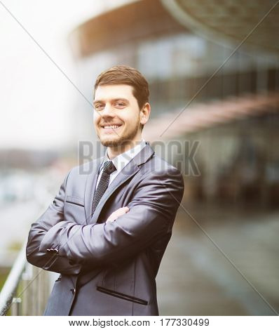Happy mature business man looking at camera with satisfaction at office