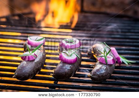 Black Pudding With Onion On The Grill And Fire