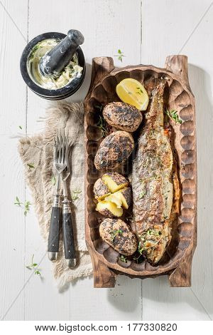 Roasted Trout Fish And Potatoes With Potato And Butter