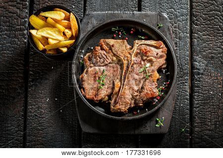 Tasty Chips And Tbone Steak With Herbs And Salt