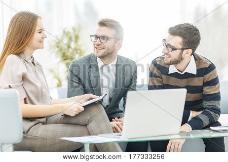 closeup of a senior Manager and members of the business team discussing a financial plan of company development in the workplace.the photo has a empty space for your text.