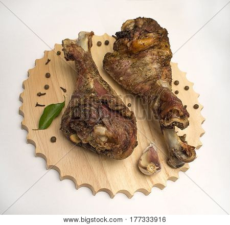 Grilled Turkey legs on the wooden board