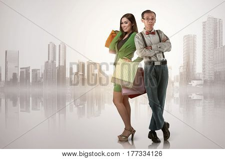 Happy Asian Woman With Shopping Bags Standing With Nerdy Man