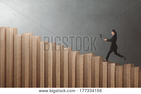 Young Asian Businesswoman Walking Up On Staircase With Laptop