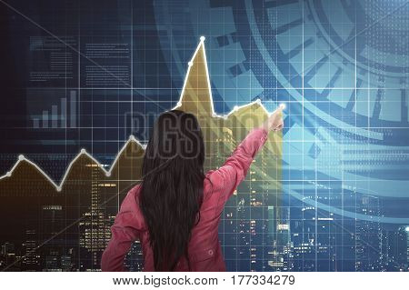 Back View Of Asian Business Woman Pointing Chart
