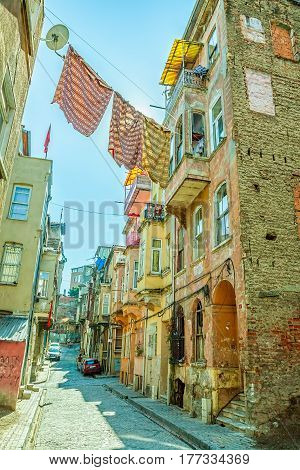 ISTANBUL, TURKEY - SEPTEMBER 28: Street with old traditional houses and filigree sidewalk in Phanar district inside the walls of Constantinople on September 28th, 2013 Istanbul, Turkey.