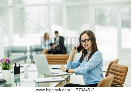 Manager Finance in the workplace in a modern office.the photo has a empty space for your text