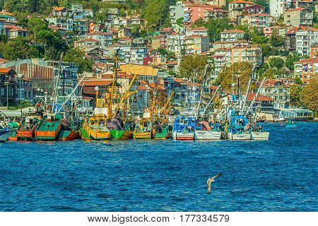 ISTANBUL, TURKEY - SEPTEMBER 28: Fishing boats moored in the small fishing harbor Sariyer on September 28th, 2013 Istanbul, Turkey.