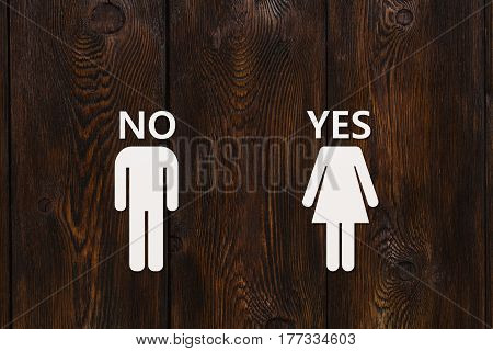 Paper man with NO text and woman with YES on wooden background. Unrequited love or divorce concept. Abstract conceptual image