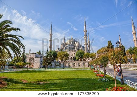 ISTANBUL, TURKEY - SEPTEMBER 27: Tourist walking around Blue mosque and Sultanahmet park on September 27th, 2013 Istanbul, Turkey. The biggest mosque in Istanbul of Sultan Ahmed, Ottoman Empire.