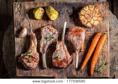 Hot Roasted Lamb Ribs On The Burnt Black Table