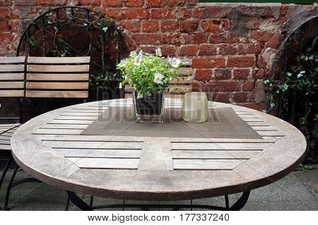 Circle table and chairs of small cafe on a street of Bremen, Germany.