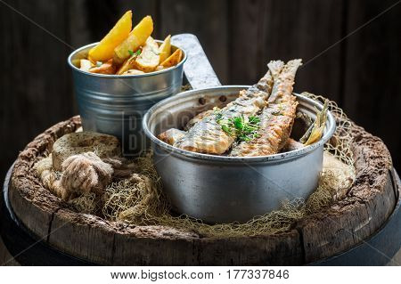 Homemade Herring Fish And Chips With Herbs And Salt