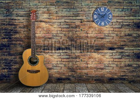 acoustic guitar in empty room with old brick wall