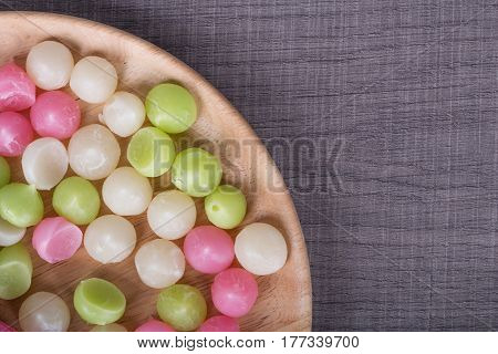 Aalaw Or Alua, Thai Traditional Candy Sweet Dessert In Plate On Wood Table