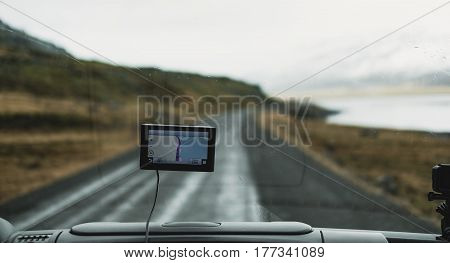 automobile front view with digital navigation gadget
