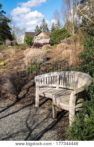Wood bench and waking path in a garden