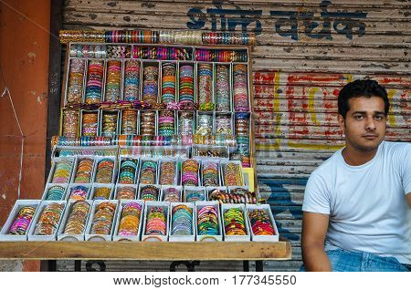 Jaipur, Rajasthan, India - Circa October 2010 - A shot of an unidentified Indian man selling colorful bangles by the street