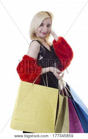 Photo of glamorous shopper with lots of bags isolated on white background