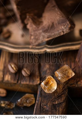 Pieces of caramel and bittersweet dark chocolate, close-up view