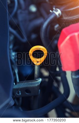 Dipstick of lubricant oil of car engine. poster