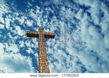 Christian Cross over blue sky concept of religion