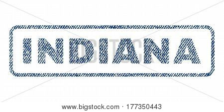 Indiana text textile seal stamp watermark. Blue jeans fabric vectorized texture. Vector caption inside rounded rectangular shape. Rubber sign with fiber textile structure.