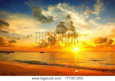 Sunset Beach with beautiful sky landscape. Travel, Tourism, Vacation concept background. Mexico. Paradise scene of Caribbean Sea Island. Sun, sand and waves